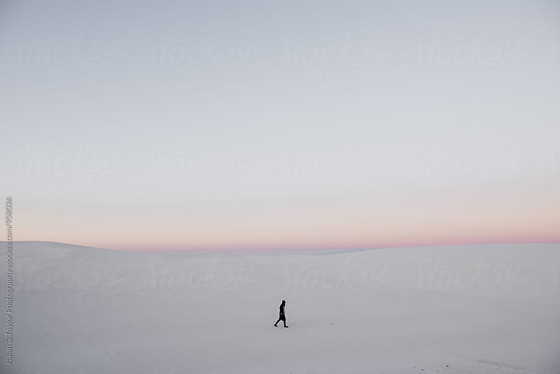 Small person walking through vast landscape by Isaiah & Taylor Photography for Stocksy United