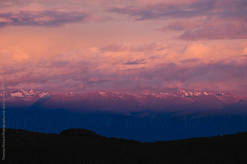 Sunset over mountains, West Coast of the South Island, New Zealand by Thomas Pickard Photography Ltd. for Stocksy United