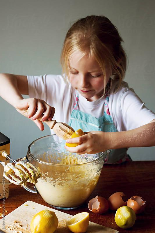 Little girl making lemon cake by Helen Rushbrook for Stocksy United