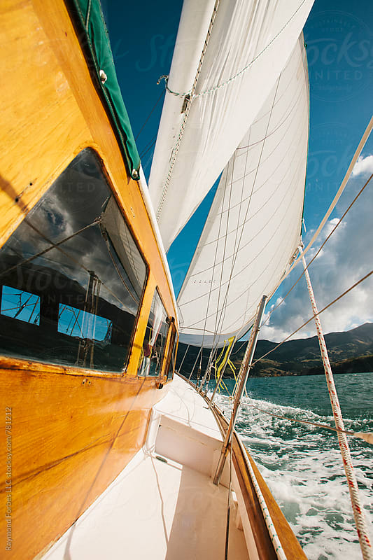 Sailboat in Akaroa Harbor, New Zealand by Raymond Forbes LLC for Stocksy United