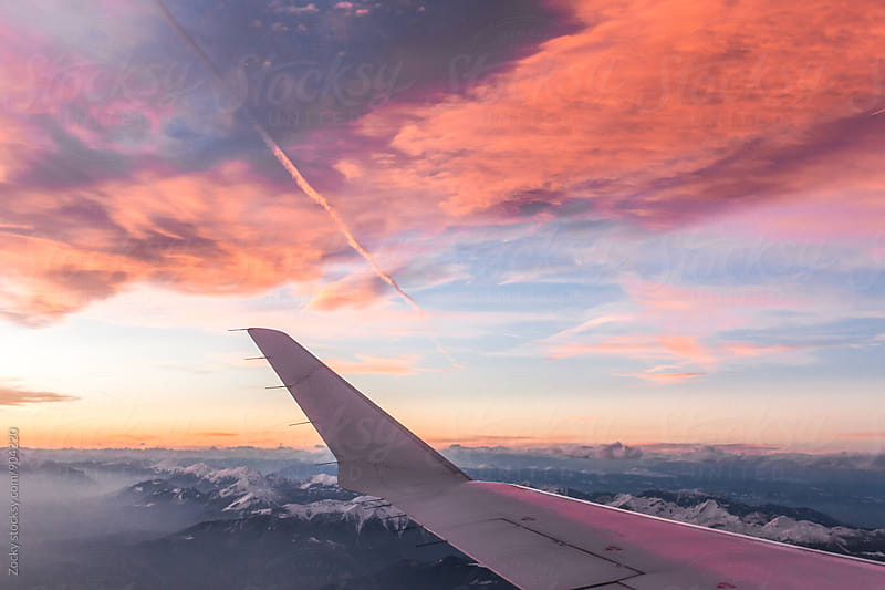Sunset out of plane window by Zocky for Stocksy United