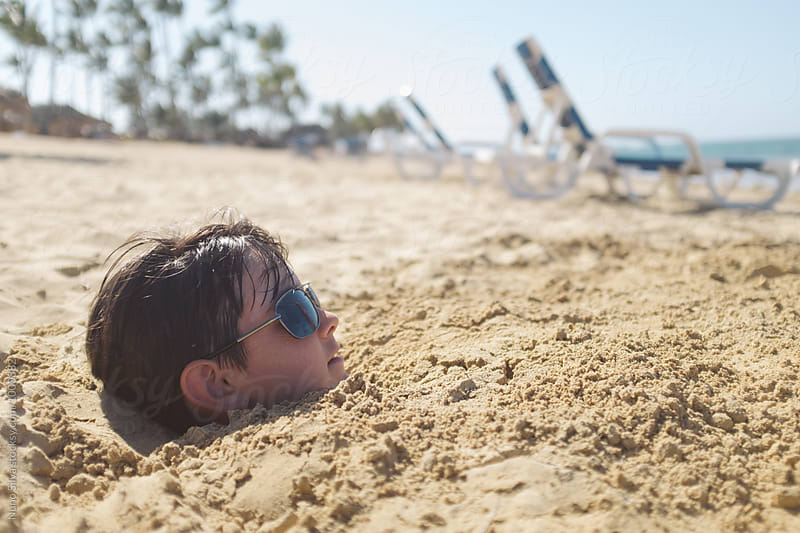 Buried in the sand. by Nuno Silva for Stocksy United