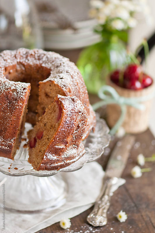 a slice of cherry and yogurt cake by Laura Adani for Stocksy United