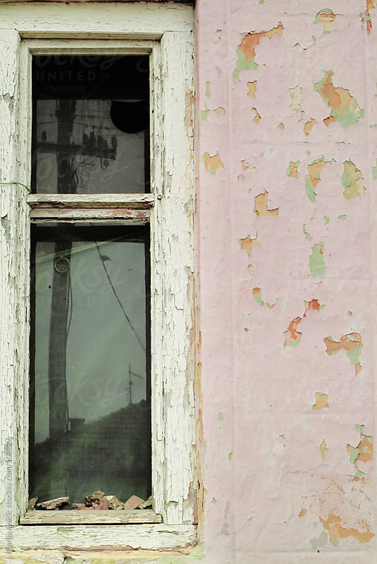 window in grungy fasade by Marija Anicic for Stocksy United