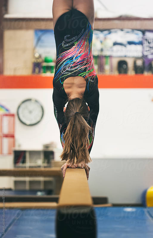 Gymnastics: Girl Does A Handstand On The Balance Beam by Sean Locke for Stocksy United