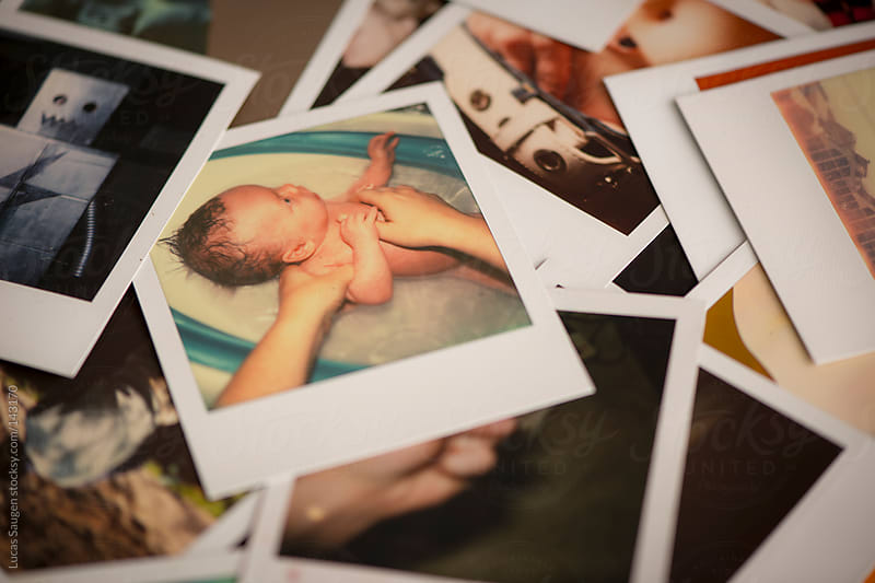 Polaroid of a newborn baby boy taking a bath. by Lucas Saugen for Stocksy United