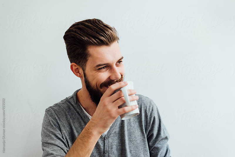 Handsome Bearded Man Having a Cup of Coffee by Nemanja Glumac for Stocksy United