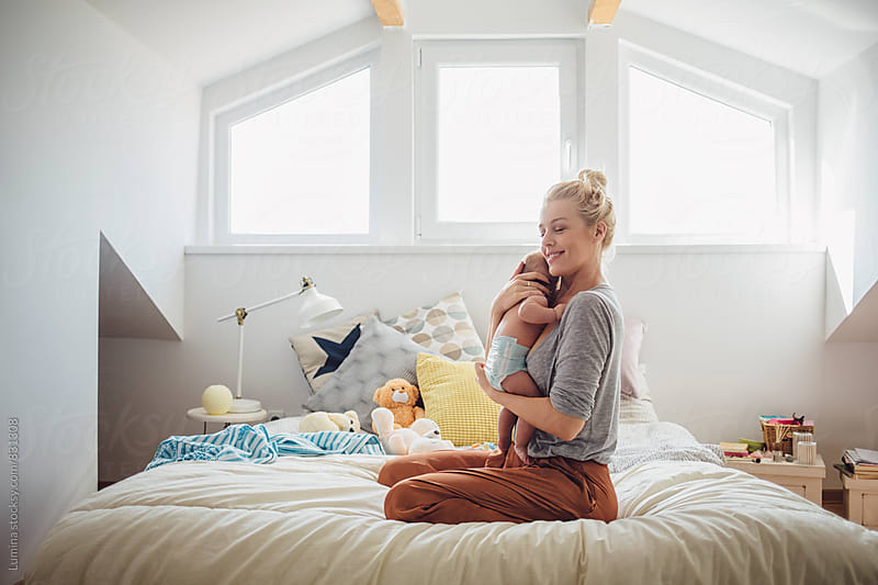 Mother Hugging Her Baby by Lumina for Stocksy United