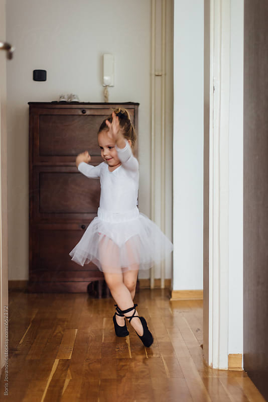Young child dancing like ballerina by Boris Jovanovic for Stocksy United