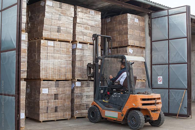Wood floor manufacturer warehouse by Jelena Jojic Tomic for Stocksy United