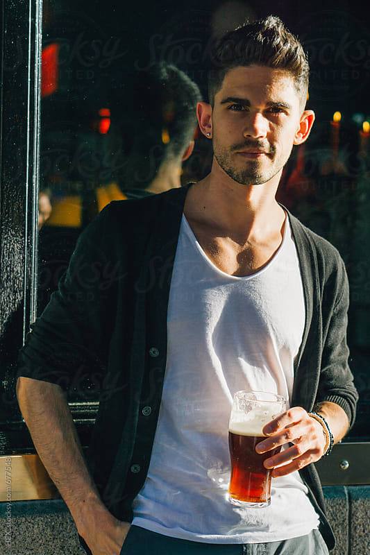 Handsome Man Drinking a Pint of Beer Outdoor by HEX . for Stocksy United
