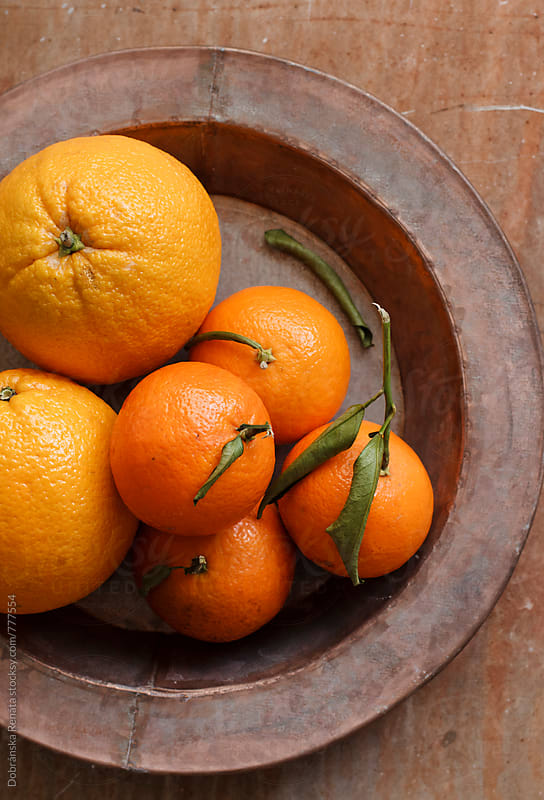 Fresh oranges and clementines by Dobránska Renáta for Stocksy United