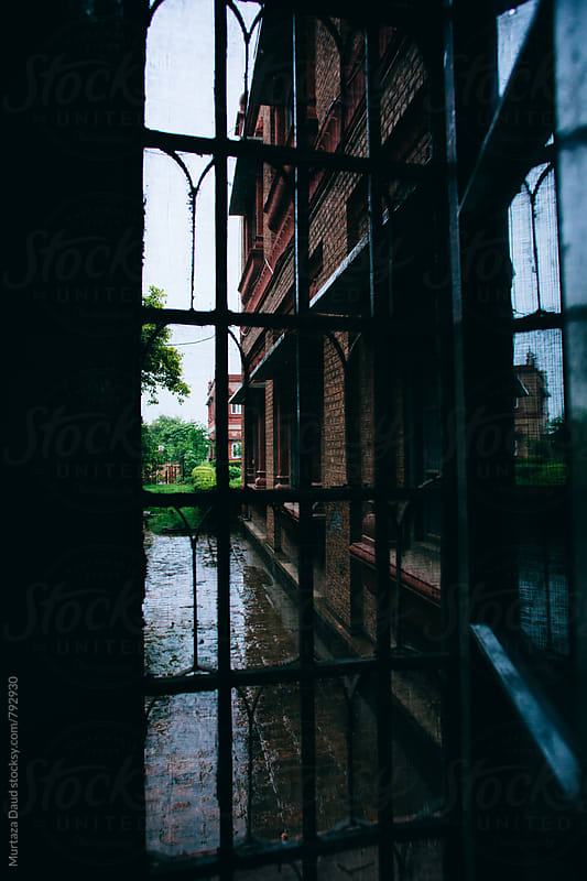 Rainy front through a classic window by Murtaza Daud for Stocksy United