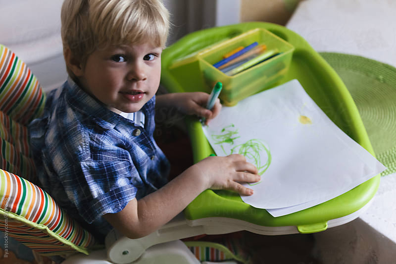 Baby boy playing drawing indoors by Ilya for Stocksy United