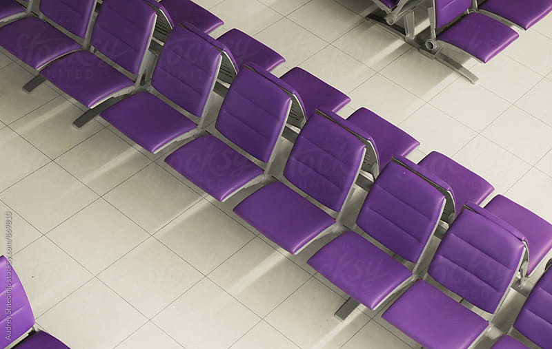 Row of purple chairs in waiting hall by Marko Milanovic for Stocksy United