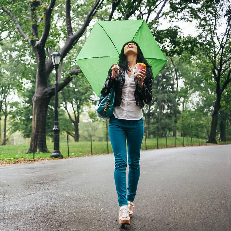 Woman walking under the rain  by GIC for Stocksy United