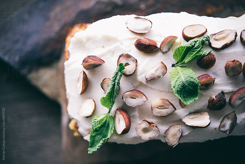 Walnuts and mint decorated cake by Adrian Cotiga for Stocksy United