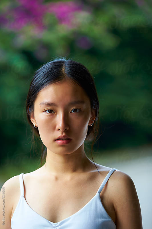 portrait of lovely asian young woman by Bo Bo for Stocksy United