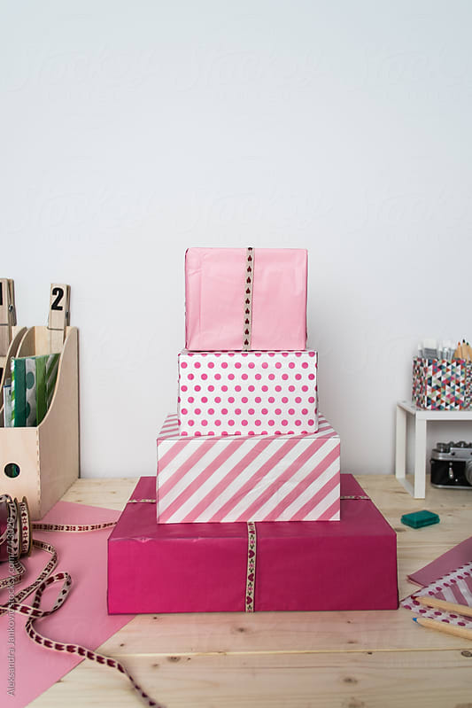 Stacked Pink Presents on the Desk by Aleksandra Jankovic for Stocksy United