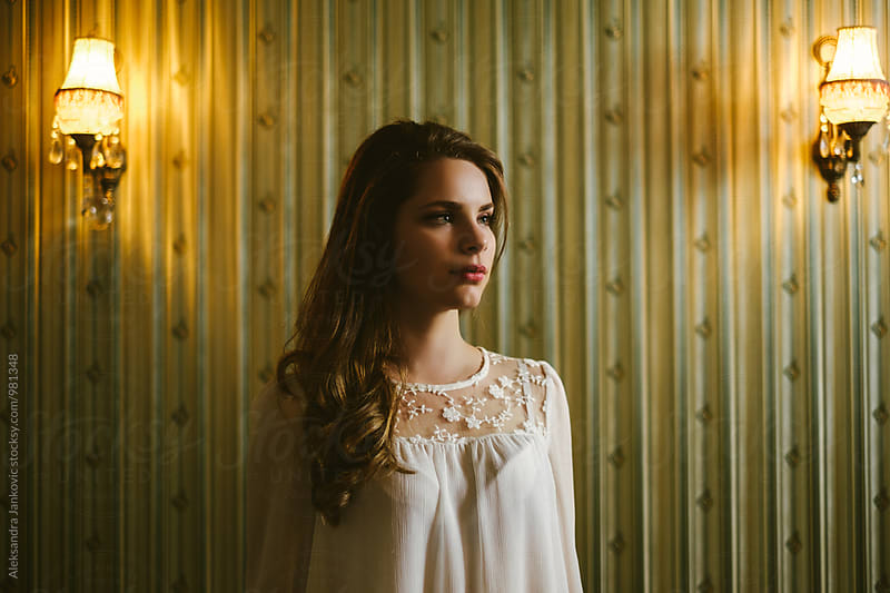 Dramatic Portrait of a Beautiful Woman in Front of the Vintage Wallpaper by Aleksandra Jankovic for Stocksy United