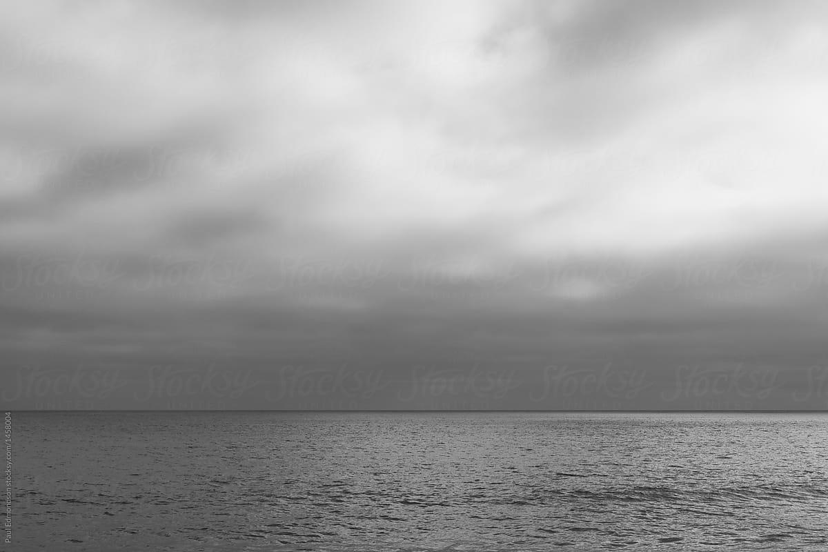Overcast sky and vast ocean by Rialto Images - Ocean