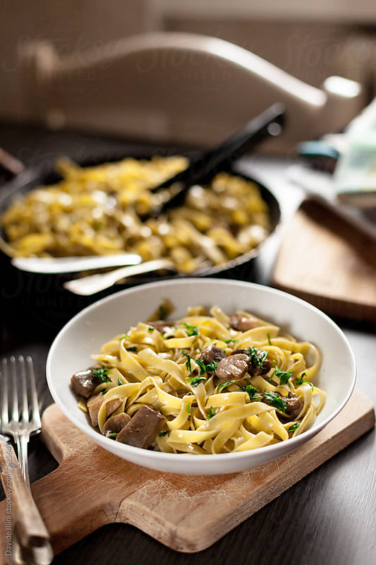 Tagliatelle with mushrooms by Davide Illini for Stocksy United