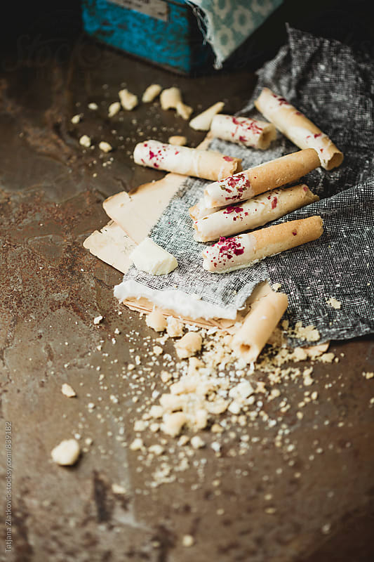 Cigarette cookies with white chocolate and rose buds by Tatjana Zlatkovic for Stocksy United