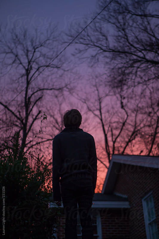 Man Watching Sunset by Lauren Light for Stocksy United