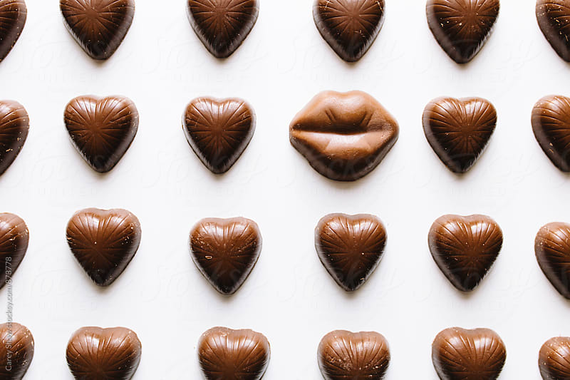 Grid of chocolate hearts and lips candy by Carey Shaw for Stocksy United