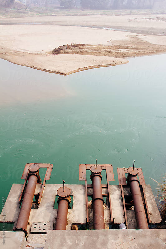 The water intake facilities in the river by zheng long for Stocksy United