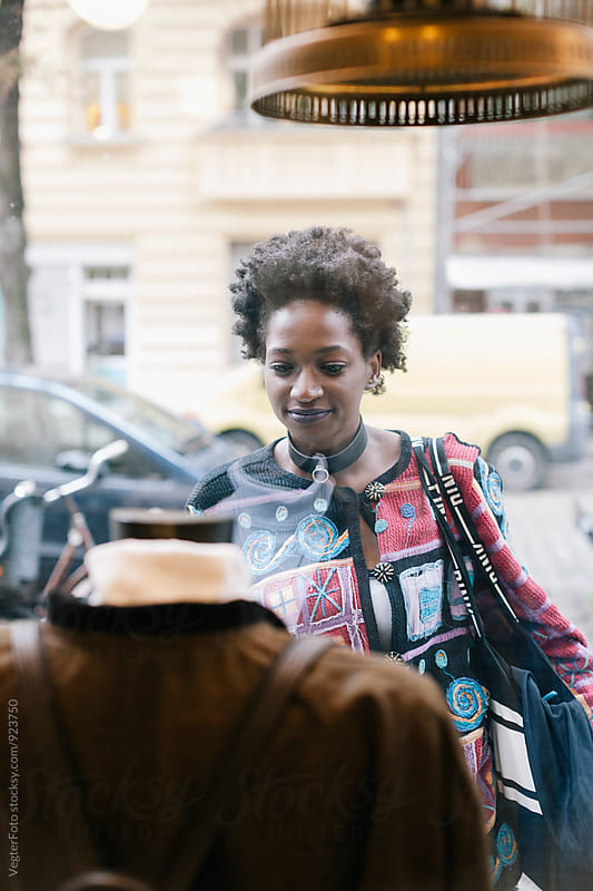 Black woman window shopping for Clothes by VegterFoto for Stocksy United