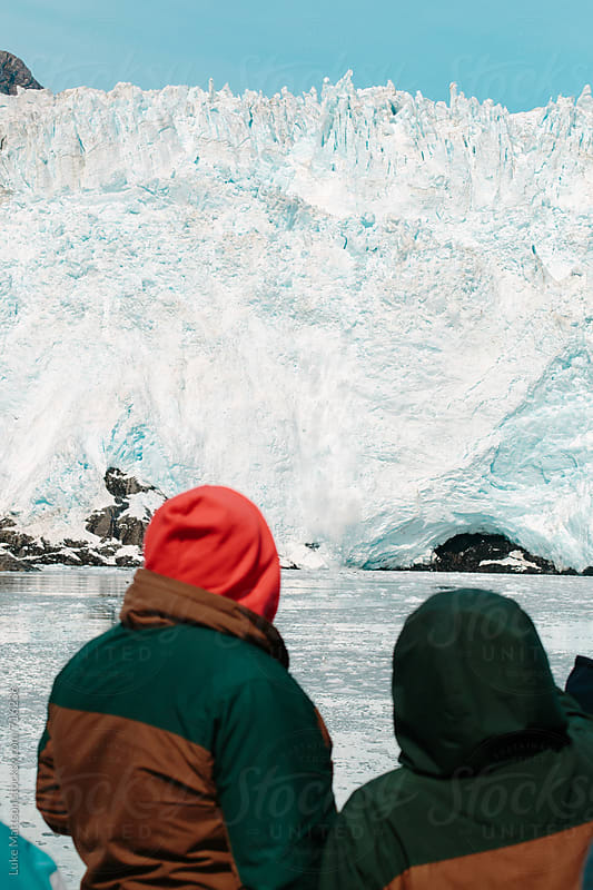 Onlookers Of A Glacier Cruise Ship Observe A Coastal Glacier Calving Into The Ocean by Luke Mattson for Stocksy United