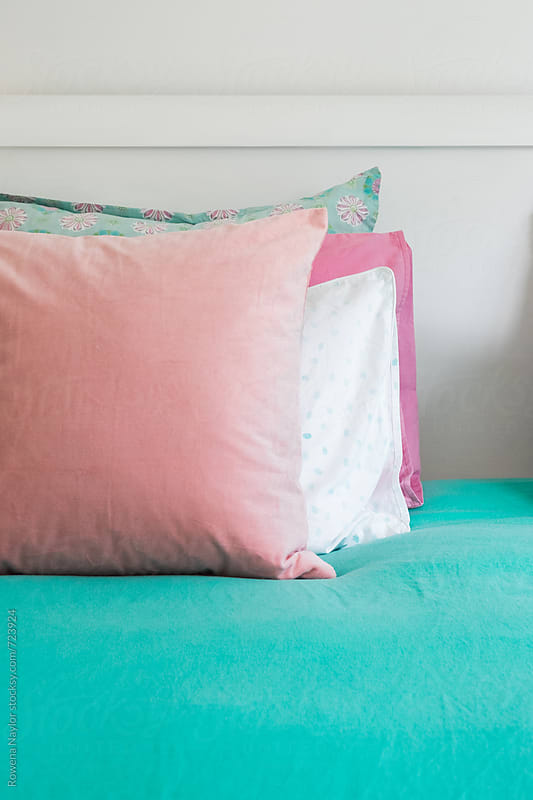 Plush cushions on bed by Rowena Naylor for Stocksy United