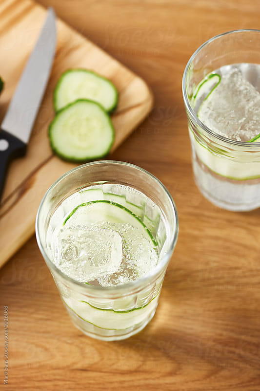 Close-up of sparkling drink with cucumber by Martí Sans for Stocksy United