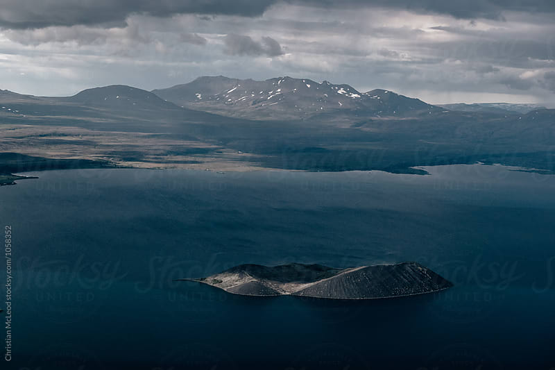 Flight over Icelandic lakes, mountains and rivers by Christian McLeod Photography for Stocksy United