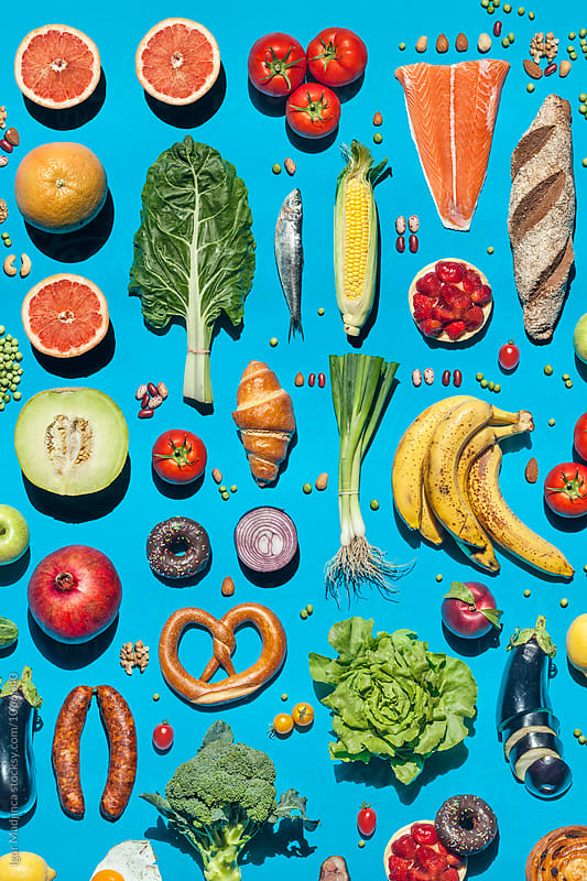 colorful foods on a blue background, diet, health, kitchen by Igor Madjinca for Stocksy United