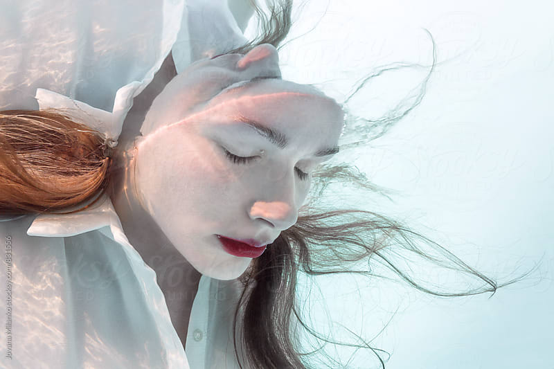 Beautiful woman submerged in water by Jovana Milanko for Stocksy United