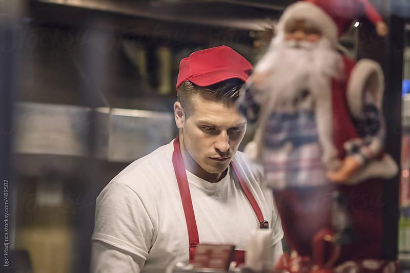 boy in a fast food restaurant by Igor Madjinca for Stocksy United