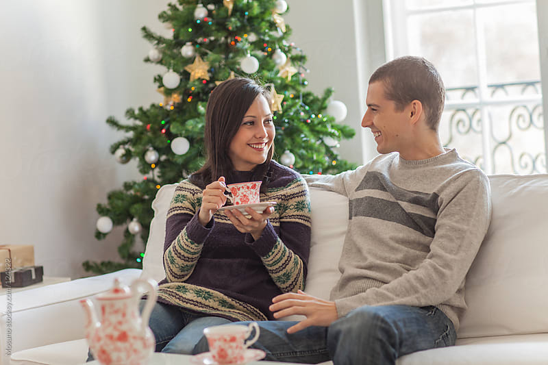 Couple Drinking Tea on the Christmas Morning by Mosuno for Stocksy United