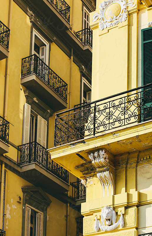 Detail shot of two yellow buildings in Naples, Italy by Aleksandar Novoselski for Stocksy United