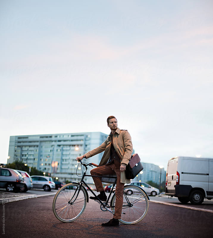 Businessman on a Bicycle by Lumina for Stocksy United
