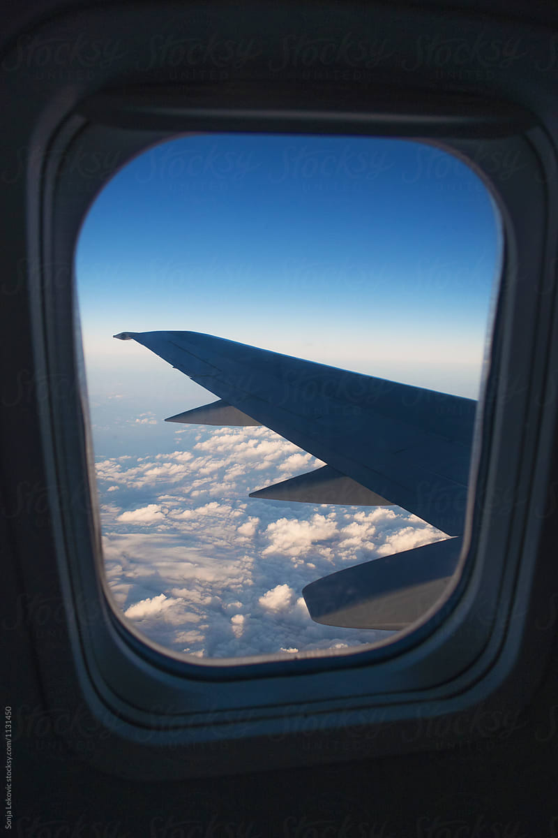 Airplane Window View By Sonja Lekovic Airplane View Stocksy
