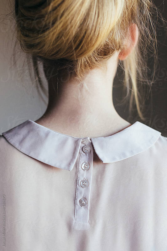 Feminine neck of young woman, from behind by Jacqui Miller for Stocksy United