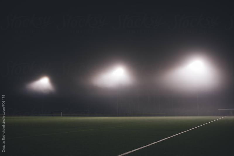 Empty stadium at night by Douglas Robichaud for Stocksy United