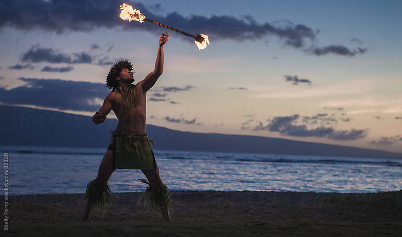 Traditional Hawaiian Fire Dancer by Shelly Perry for Stocksy United