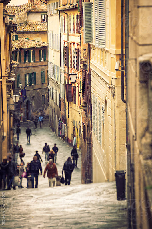 Alley with people in old town, Italy by GIC for Stocksy United