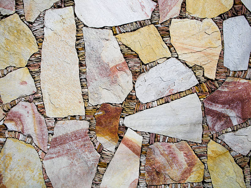 A mosaic of coloured stonework of various colours by Mike Marlowe for Stocksy United