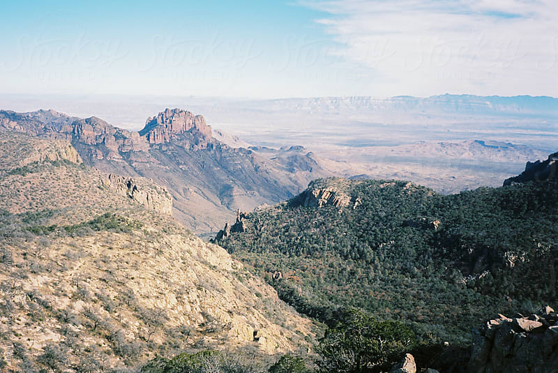 Desert and mountains from top of hike. 35mm film by Jeremy Pawlowski for Stocksy United