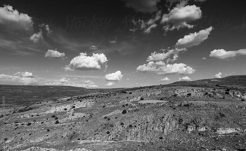 Amazing landscape in black and white with clouds on sky by Javier Pardina for Stocksy United