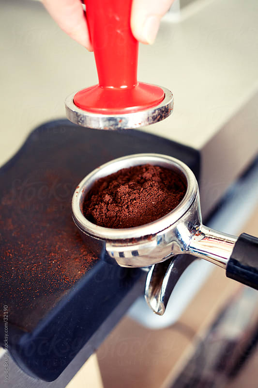 Making a classic coffee using freshly grinded coffee by Ivo de Bruijn for Stocksy United
